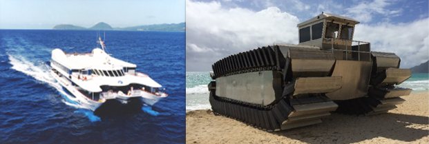 Catamaran in sea and amphibious vehicle on beach