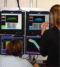 Image of researchers at workstations.