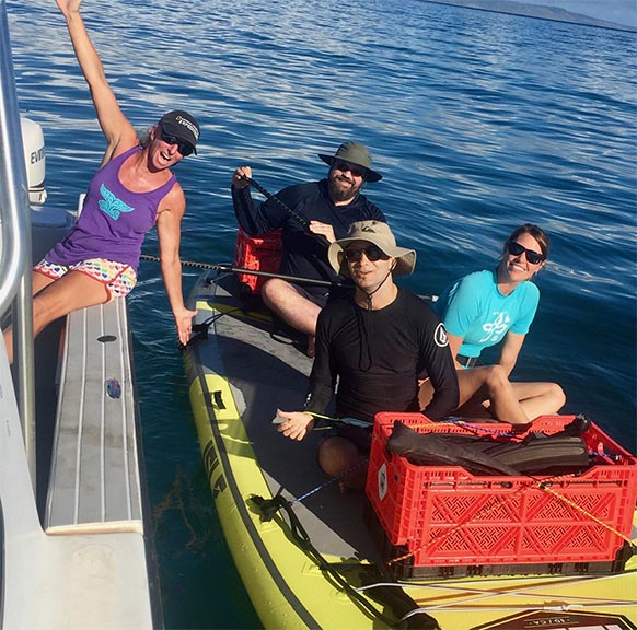 Researchers on a boat doing field work