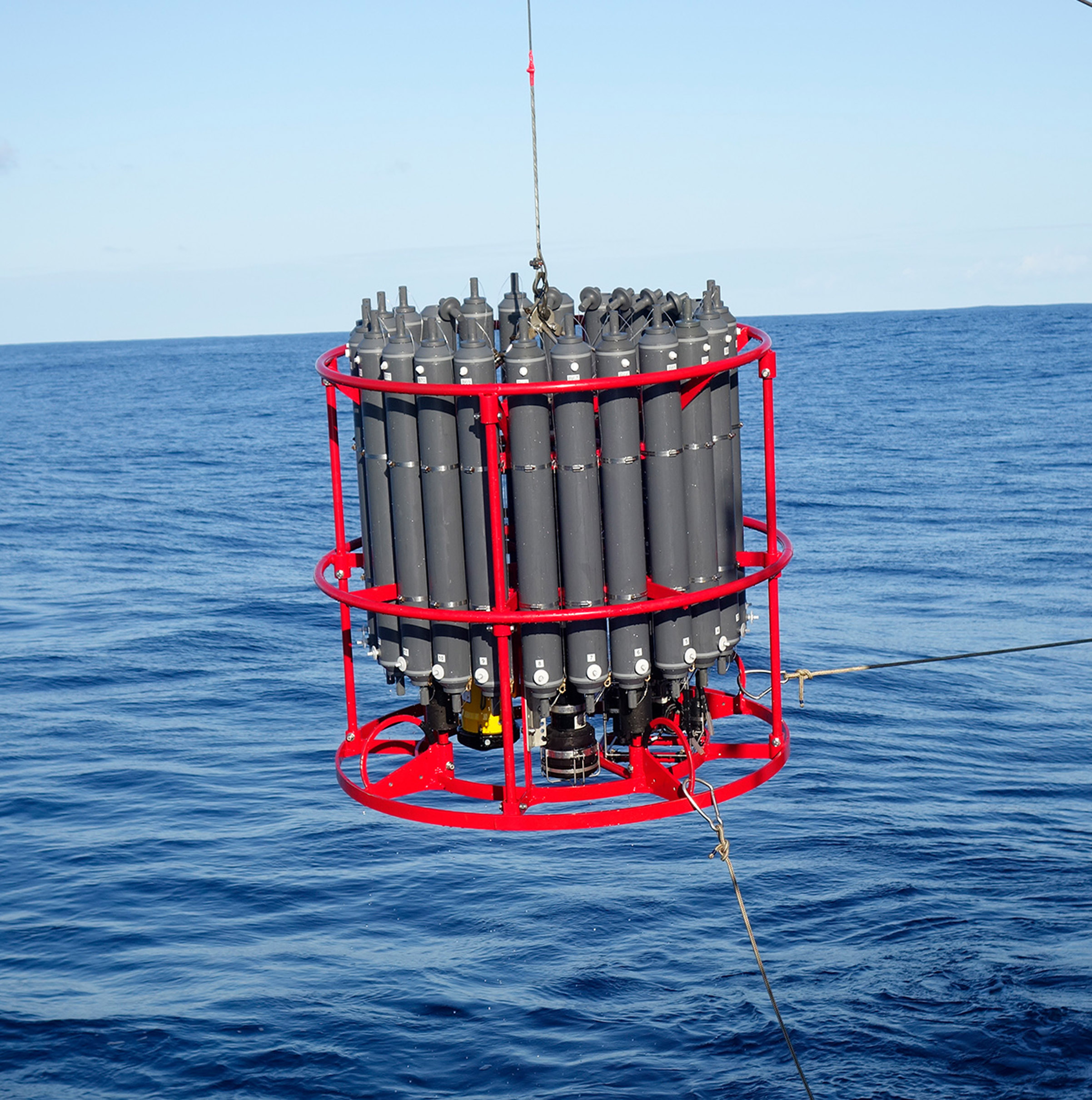 image of a CTD being lowered into the water to collect information about the water column.