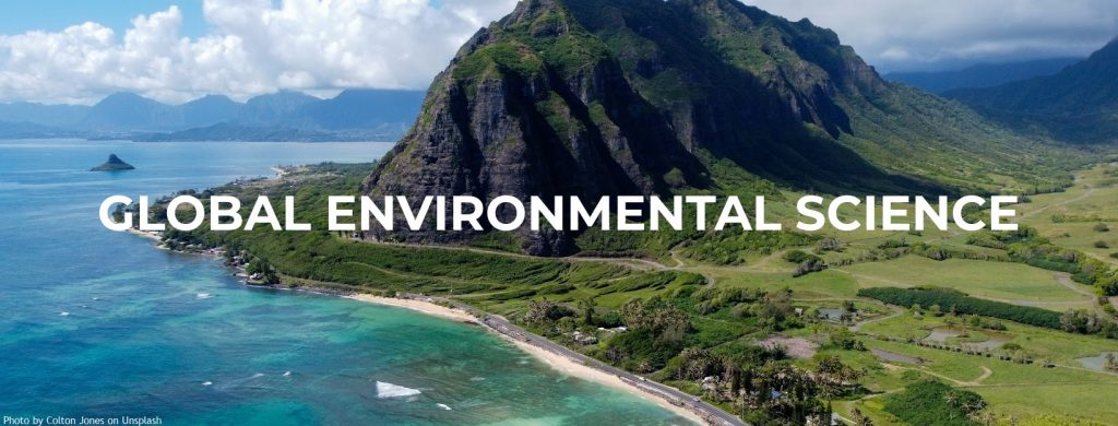 """Beautiful aerial image of large, green mountain next to the ocean. Text on image says, """"Global Environmental Science"""""""
