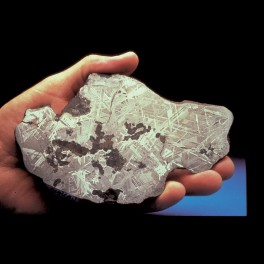 hand holding meteorite section