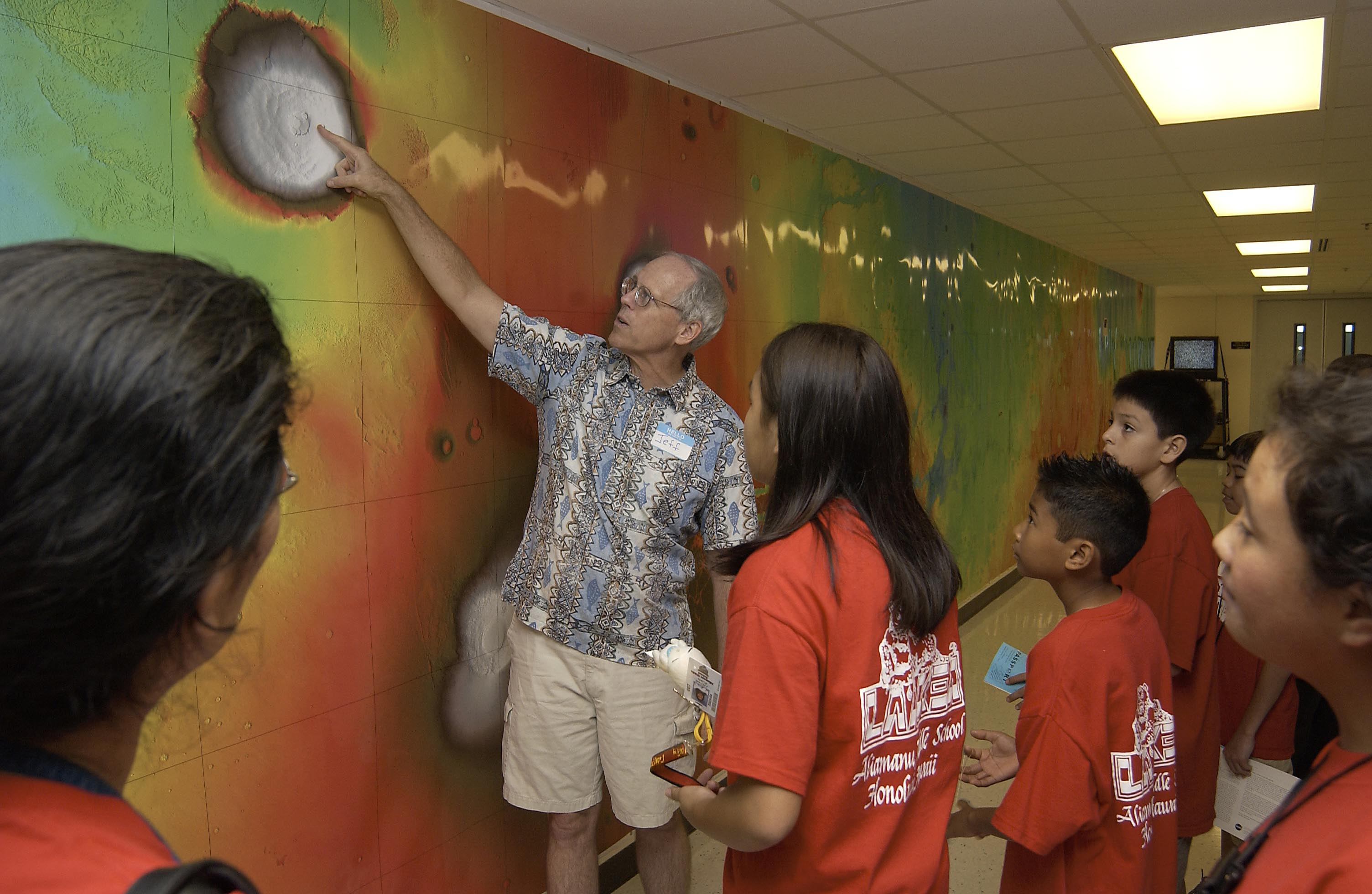 "Prof Jeff Taylor, Dir of the Space Grant program, takes some Aliamanu Middle School students on a ""Field Trip To Mars"" during Open House day. Note the huge map covering the whole hallway."