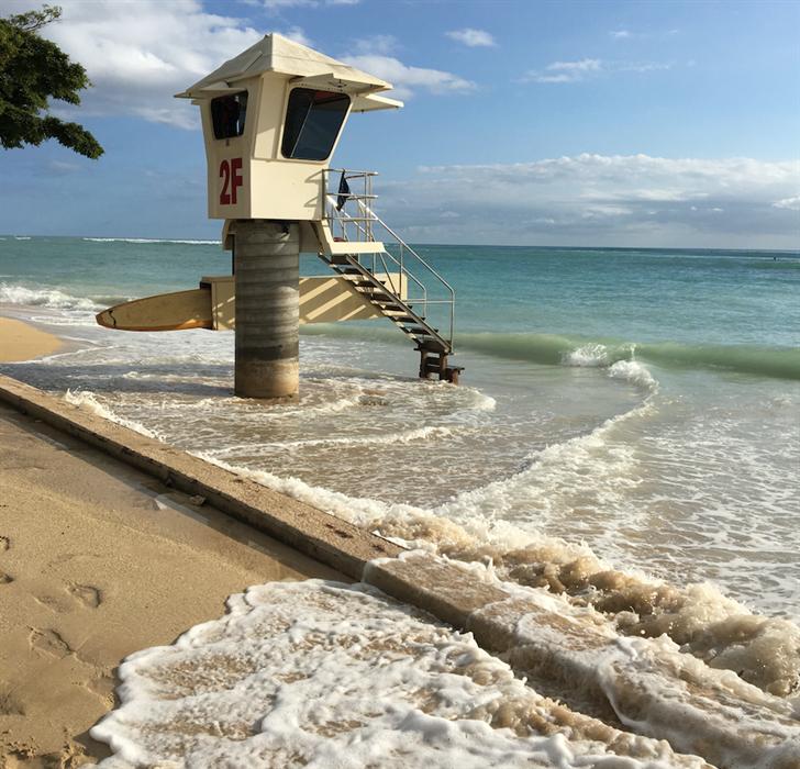 High tides reach a life guard station in Waikiki.