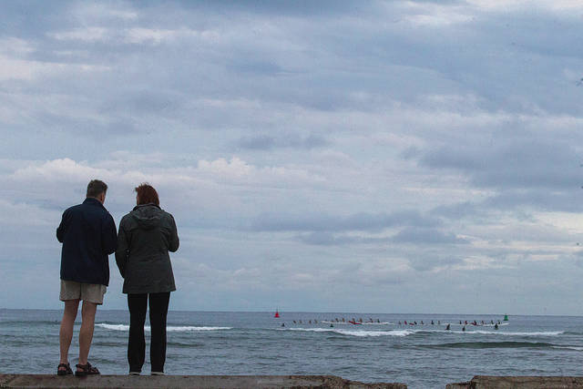 Image of people at the beach with overcast sky