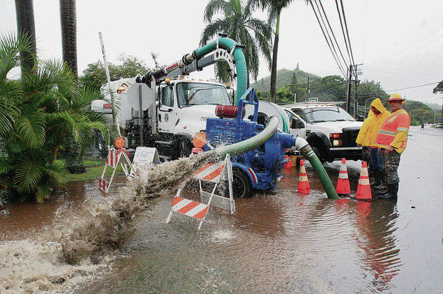 Department of Facility Maintenance workers pumped out a storm drain along Kamehameha Highway