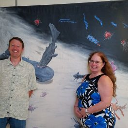 Jeff Drazen and Michelle Smith in front of the mural depicting the abyssal plain.