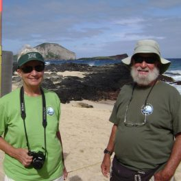Marilyn (left) and DB (right) Dunlap in front of a Hawaiian Monk Seal.