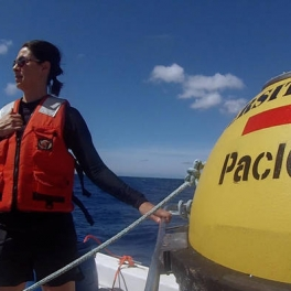 PacIOOS Director Melissa Iwamoto helps deploy the buoy off of Barbers Point.