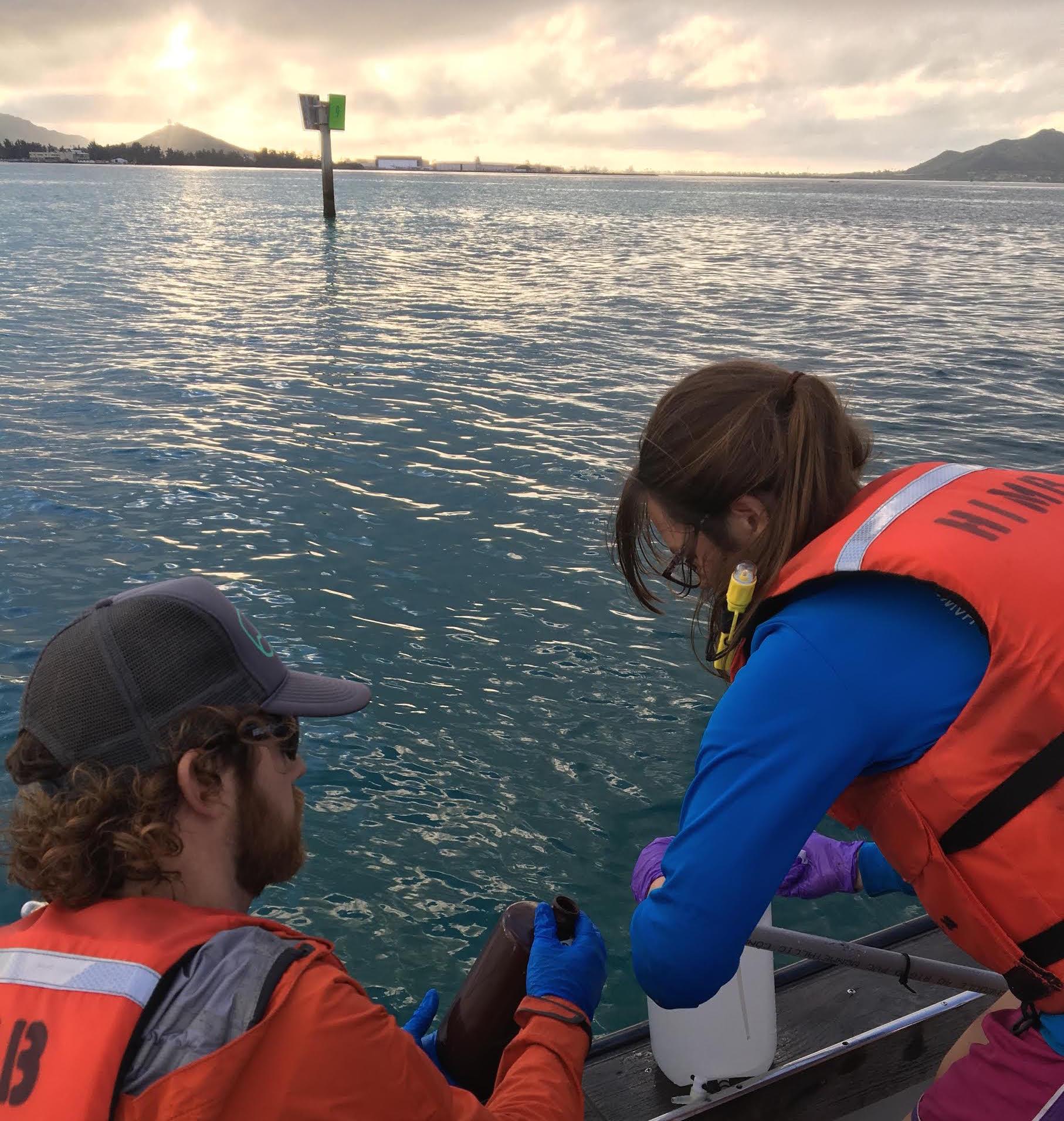 Rappe lab grad student Sarah Tucker sampling in Kaneohe Bay. Credit: Jessica Schaefer.