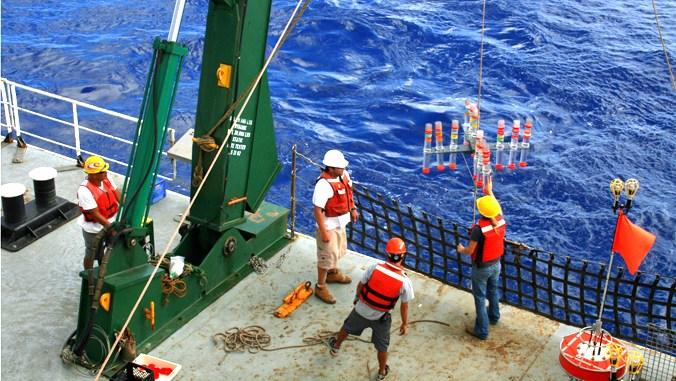 HOT team members deploying water sampling equipment. (Credit: Tara Clemente)