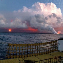 Lava going into the ocean. Photo taken from the backdeck of the UH research vessel Kaʻimikai-O-Kanaloa. Photo credit: Ryan Tabata.