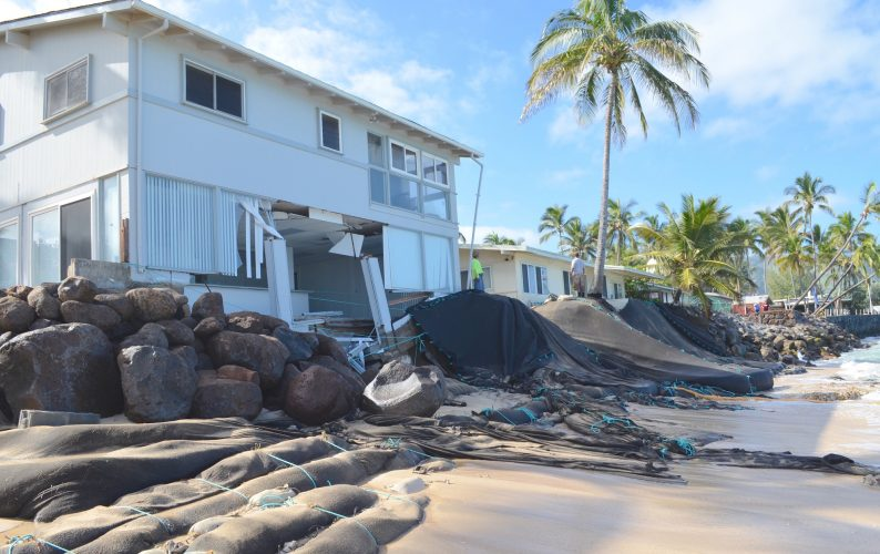 Extensive shoreline erosion near homes at Mokuleia on Oahu's northshore. Credit: Brad Romine.
