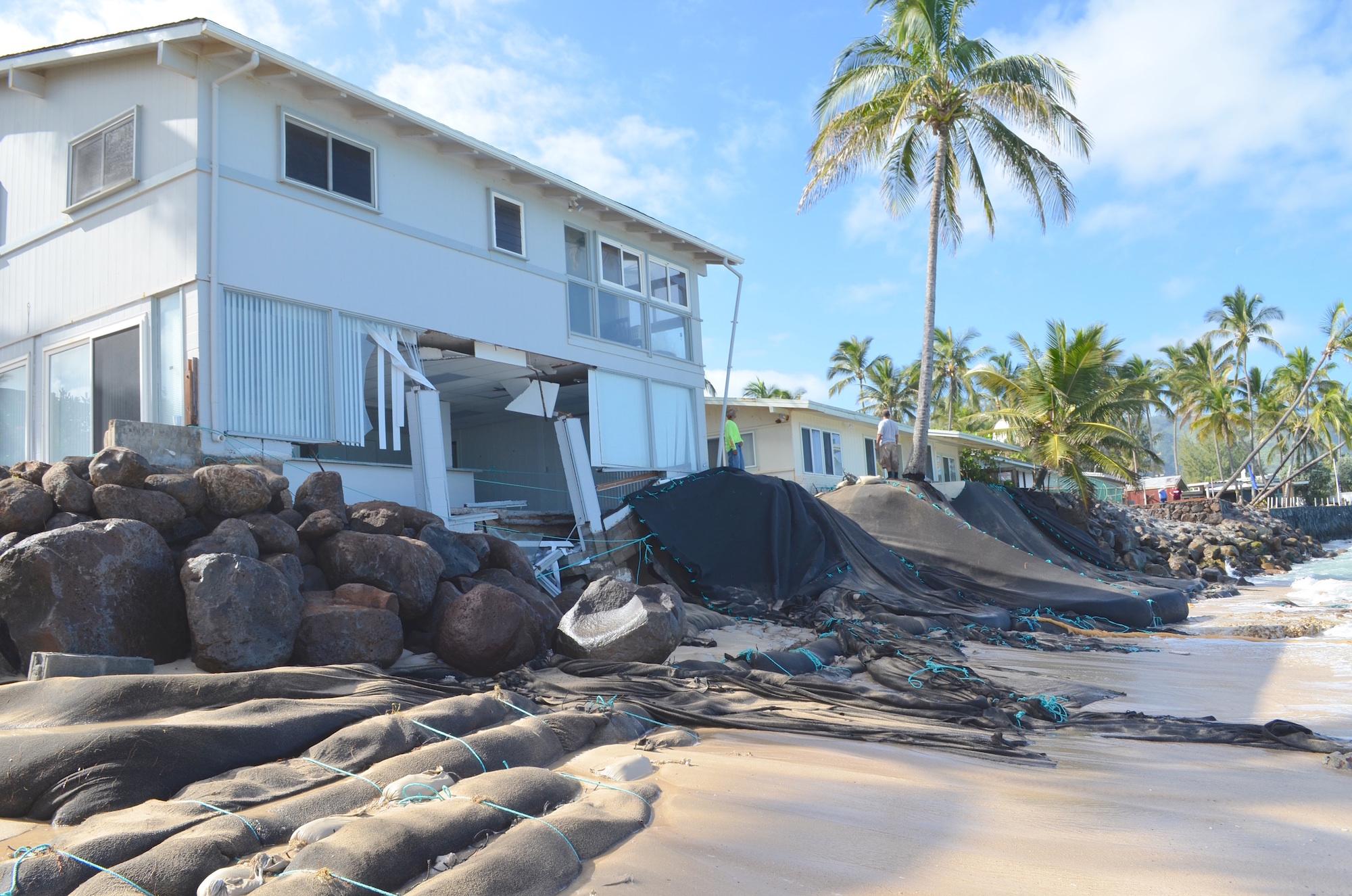 Extensive shoreline erosion near homes at Mokuleia on Oahu's northshore. Credit: Brad Romine.