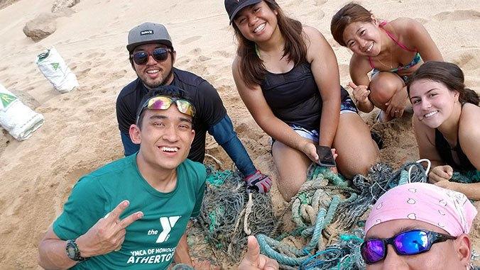 Andrew Tokuda at a beach cleanup on Molokaʻi.