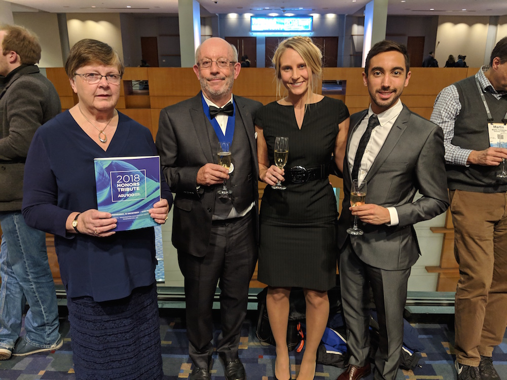 Bruce Houghton with his wife, Alison Houghton, and students, Brett Walker and Sam Mitchell at the 2018 AGU Fellow Award Ceremony.