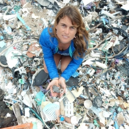 Sarah-Jeanne Royer stands atop a mound of plastic debris.