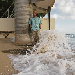Image of UH Sea Grant geologist Dolan Eversole in crashing wave
