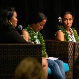 Photo of Haunani Kane, right, and Aurora Kagawa-Viviani listen to Rosie Alegado, left.