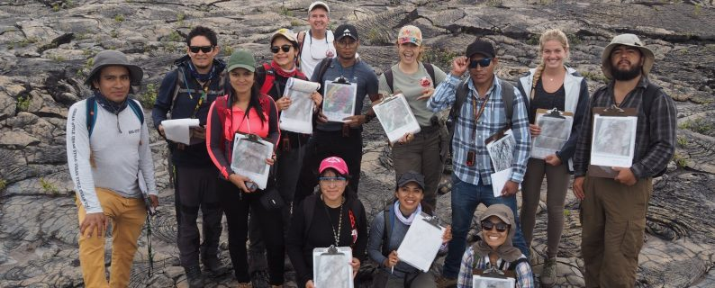 Participants in the 2019 CSAV International Volcanology Training course proudly show off geologic maps they created with remote-sensing data.  They spent this day ground-truthing their maps.