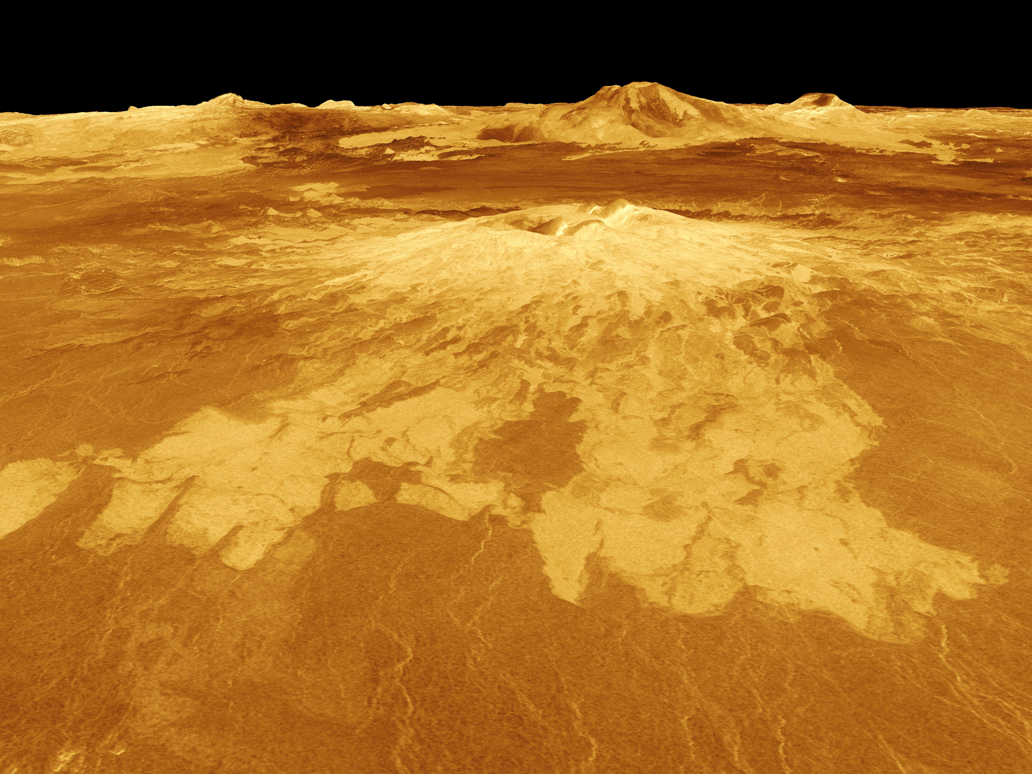 Sapas Mons, a volcano 248 miles across and nearly 1mile high, is visible in the center of this image of the surface of Venus. Credit: NASA Jet Propulsion Laboratory.