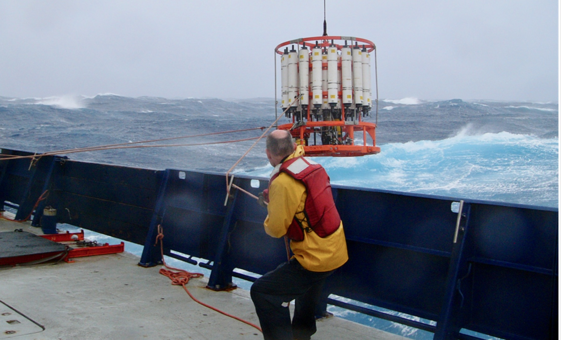 Recovering a rosette water sampler from the deck of ship. Credit: NOAA.