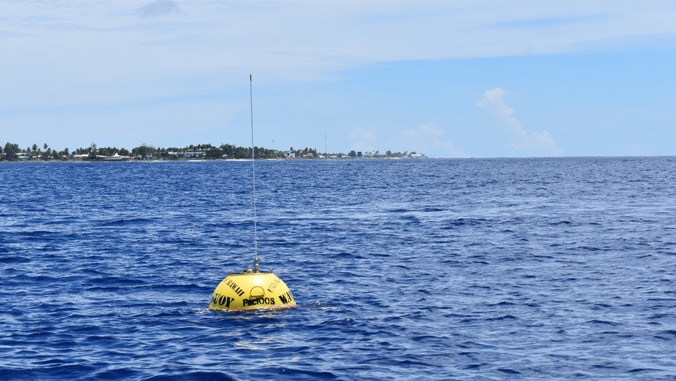 PacIOOS wave buoy off the low-lying atoll Majuro, Republic of the Marshall Islands. This buoy measured 16 feet in significant wave height during a storm in November 2019. (Photo credit: PacIOOS)