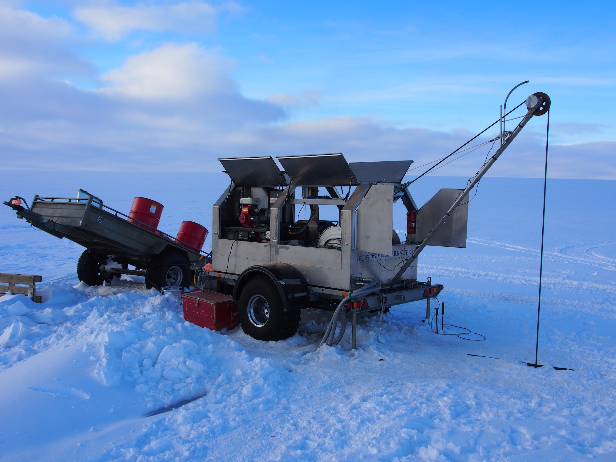 The hot water drill used to drill through the glacier to the subglacial lakes. Open, frozen landscape of the glacier surrounds the drill