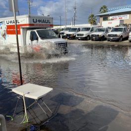 High tide nuisance flooding in Māpunapuna is a hazard to vehicular and pedestrian traffic.