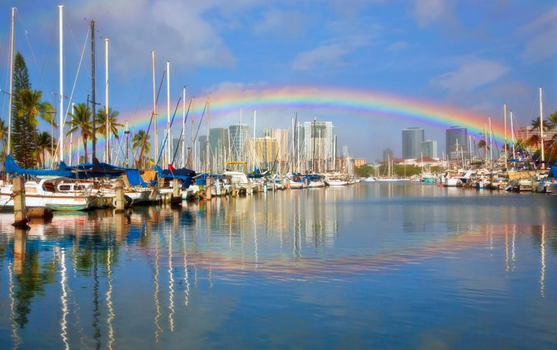 Rainbow over Honolulu Harbor with what appears to be its reflection. However, the reflected bow is not what it appears to be. See the paper for explanation.