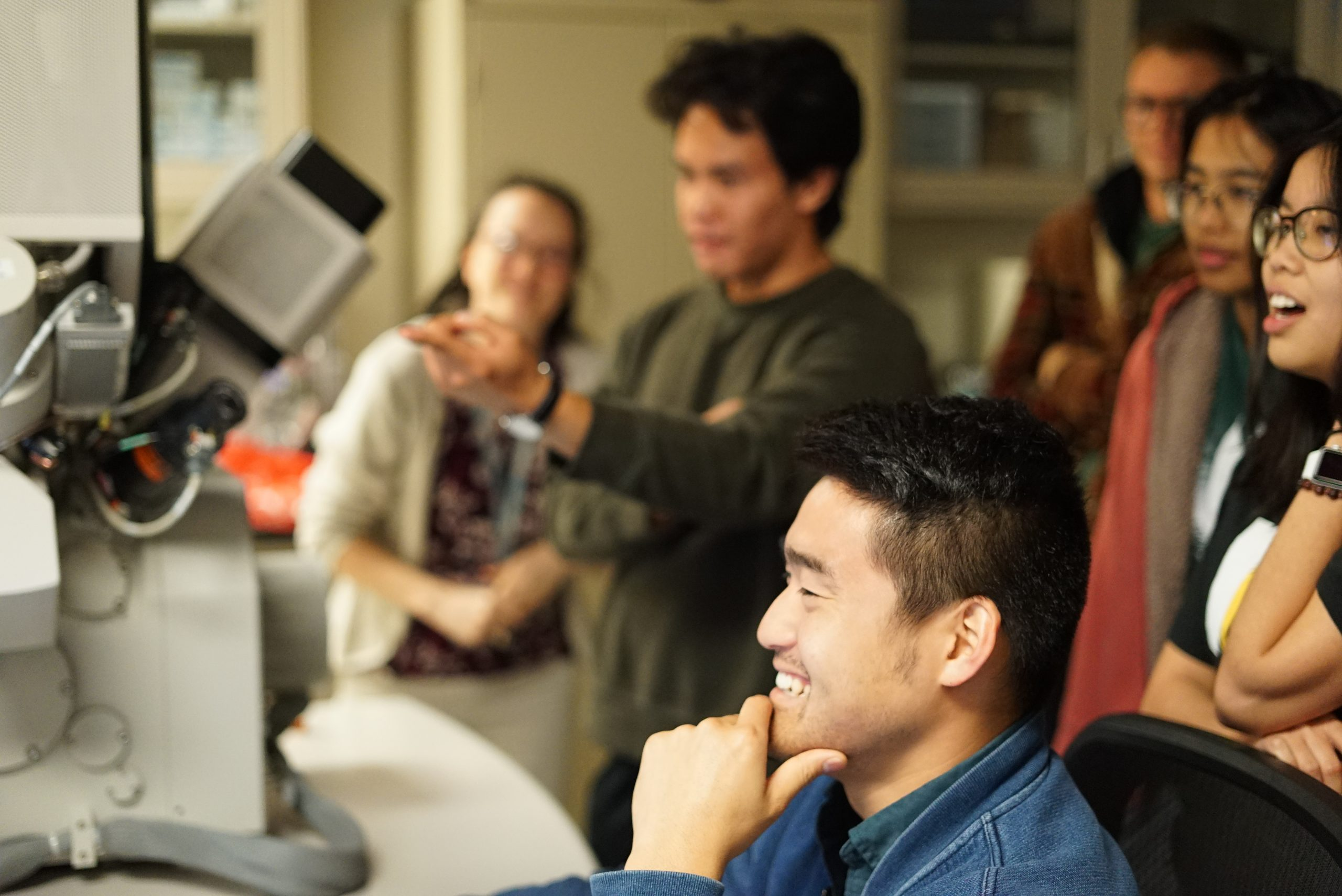 Students and Dr. Kenta Ohtaki, formerly a postdoc, working at the Focused Ion Beam instrument at HIGP.